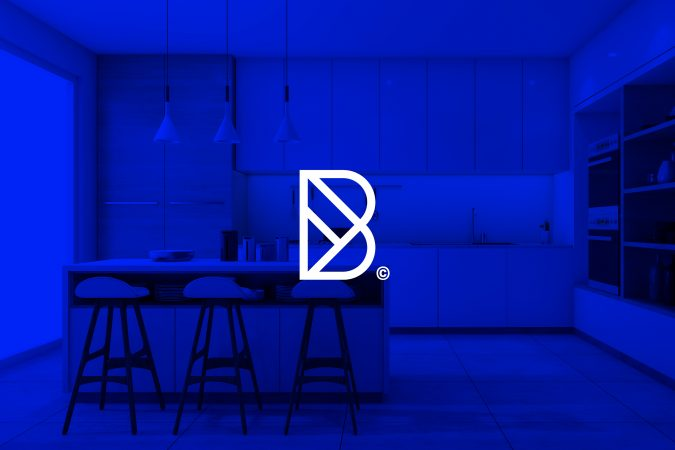 Blueprint B monogram design with a blue tinted kitchen as the background